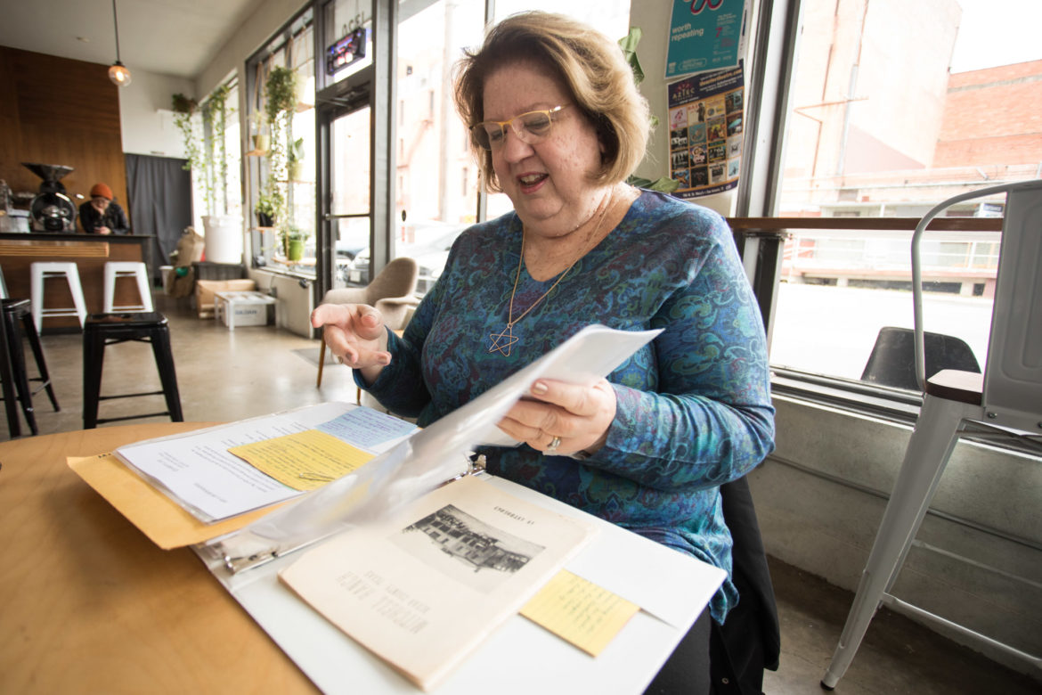 Martha James flips through a book of her family history.