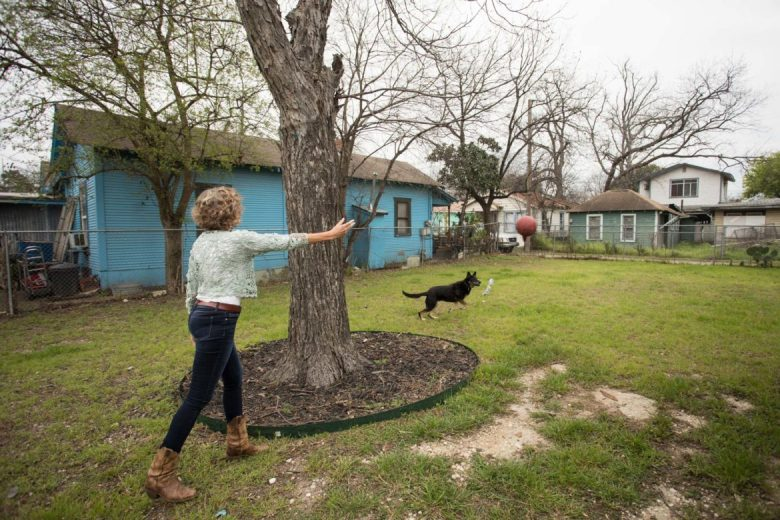 Linda Stone throws a ball for her rescue shepherd Pelusa in her backyard.
