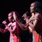 The Moipei Triplets perform on stage with YOSA.
