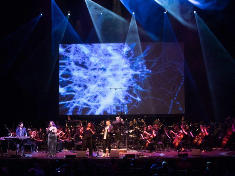 Carly Garza & Jaime Ramirez perform on stage with YOSA.