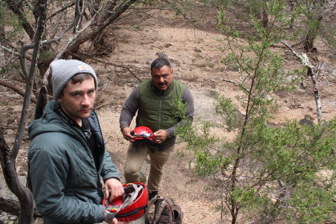 From left, Max O'Roark and Joedy Yglesias put on caving helmets at Colorado Bend State Park.