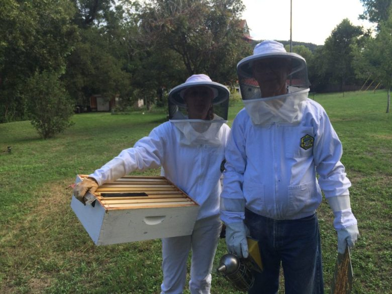 Liz Rendon and her father Lee Leffingwell service a bee hive on Lee's property along the Guadalupe River.