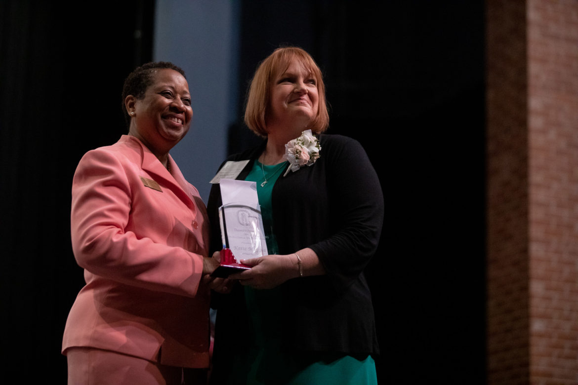 Library Media Specialist Katie Michna (right) receives the Trinity Prize for Excellence in Teaching from Deneese Jones