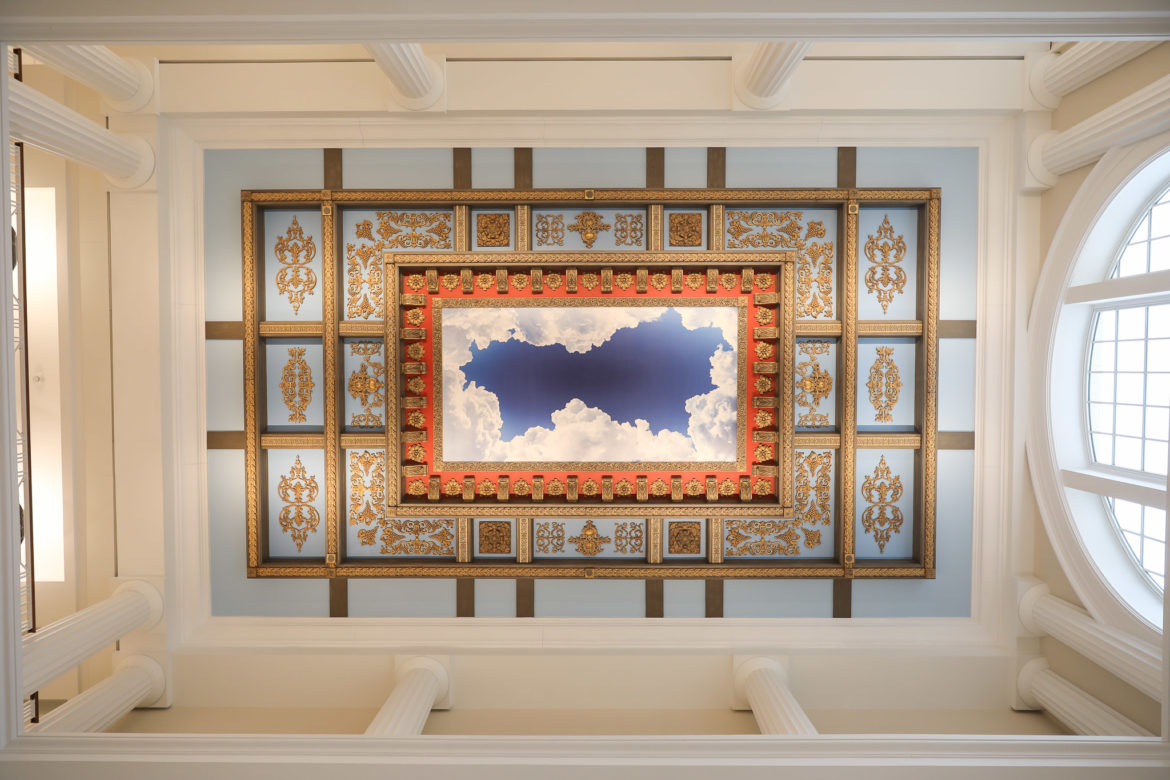 A large design of a sky surrounded by clouds is featured in one of the entry areas.