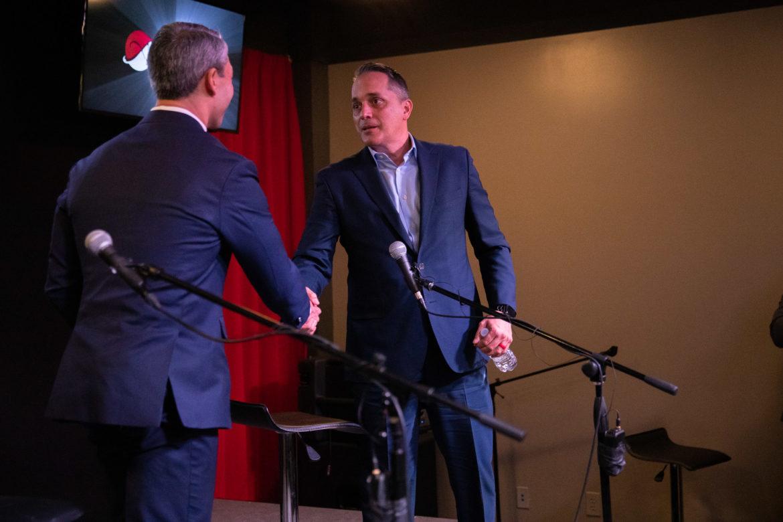 Mayor Ron Nirenberg and Councilman Greg Brockhouse shake hands following the debate.