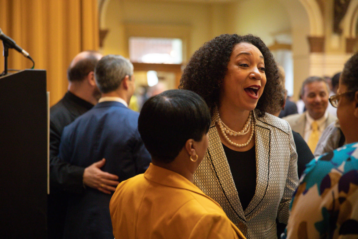 Sage President and CEO Tuesdaé Knight speaks with attendees following the organizations annual breakfast at Sunset Station.