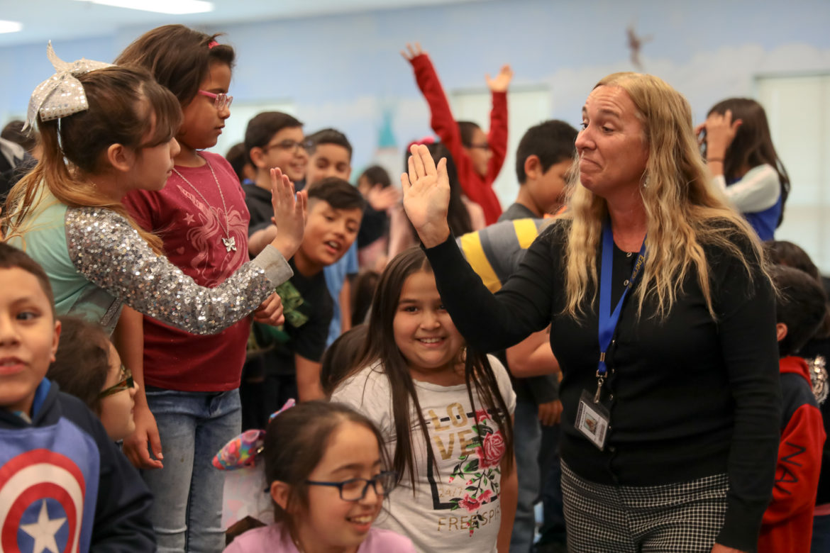 Stonewall Flanders Elementary School Principal Traci Smith is surprised as she becomes a finalist for the H-E-B Excellence in Education Awards.