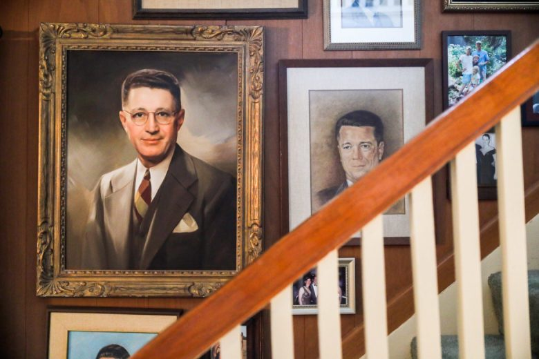 An oil painting of Walter McAllister (left) is hung in the McAllister family home.
