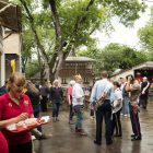 As the rain clears, more people gather outside for Gartenfest.