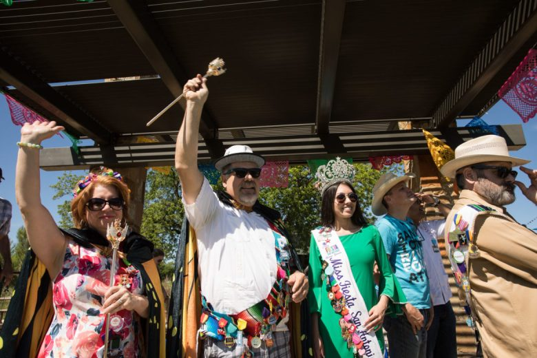 (From left) River Monarchs Treva and John Chadwell and Miss Fiesta San Antonio cheer on participants in the river parade.