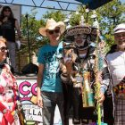 """(From left) River Monarch Treva Chadwell, Robert Amerman, Executive Director of the San Antonio River Foundation, Eddie Diaz, and River Monarch John Chadwell prepare for a photo after Diaz won the """"Pet with Person"""" costume first prize."""