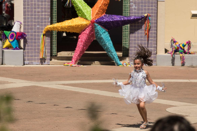 A member of the Danzavida dance troupe performs a solo at Piñatas in the Barrio.