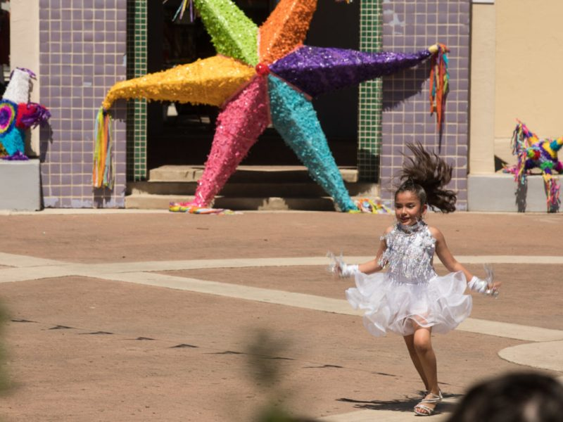 A member of the Danzavida dance troupe performs a solo at Piñatas in the Barrio.