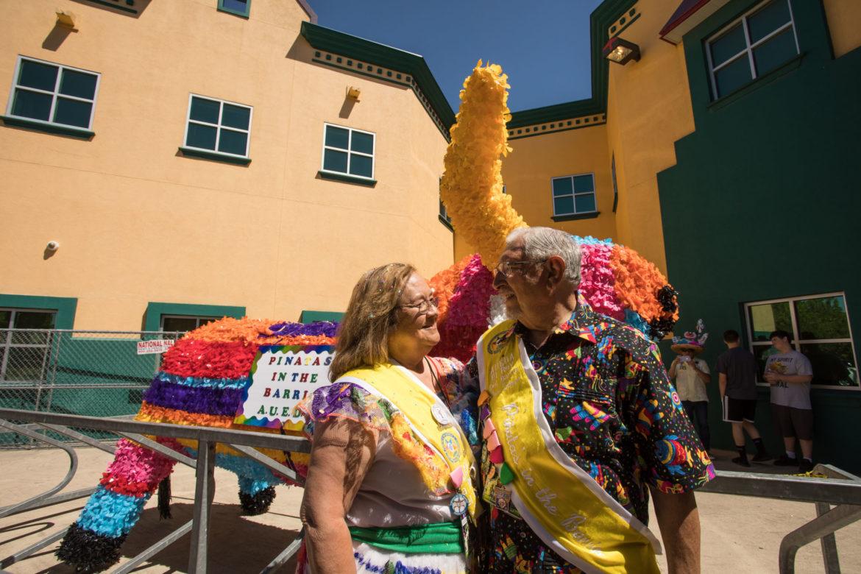 (From left) Piñatas in the Barrio Queen Gloria De Hoyos and King Jose De Hoyos.