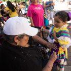 Escaramuza Rosas De Castilla director Rosemary Encina helps Melanie fix her dress.