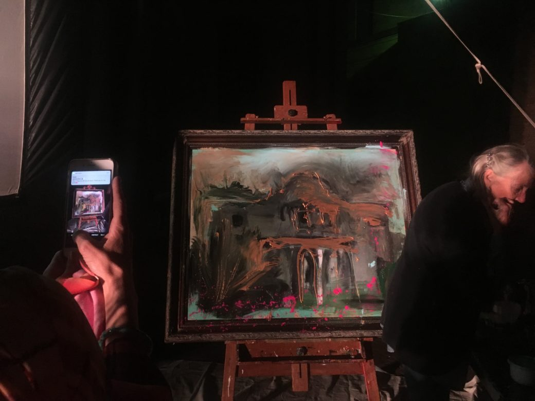 An oil painting of the Alamo was created on stage by artist and Pecha Kucha presenter Franco Mondini-Ruiz.