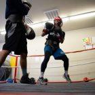 Denry Haro (left) spars against Calvin Baez at Advocates Youth Gym.
