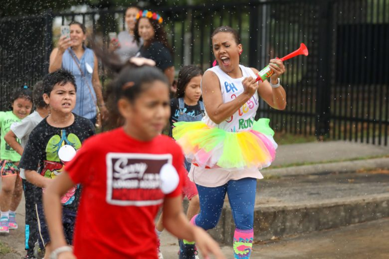 Beacon Hill Academy Principal Laryn Nelson exercises with her students during the Fiesta Run.