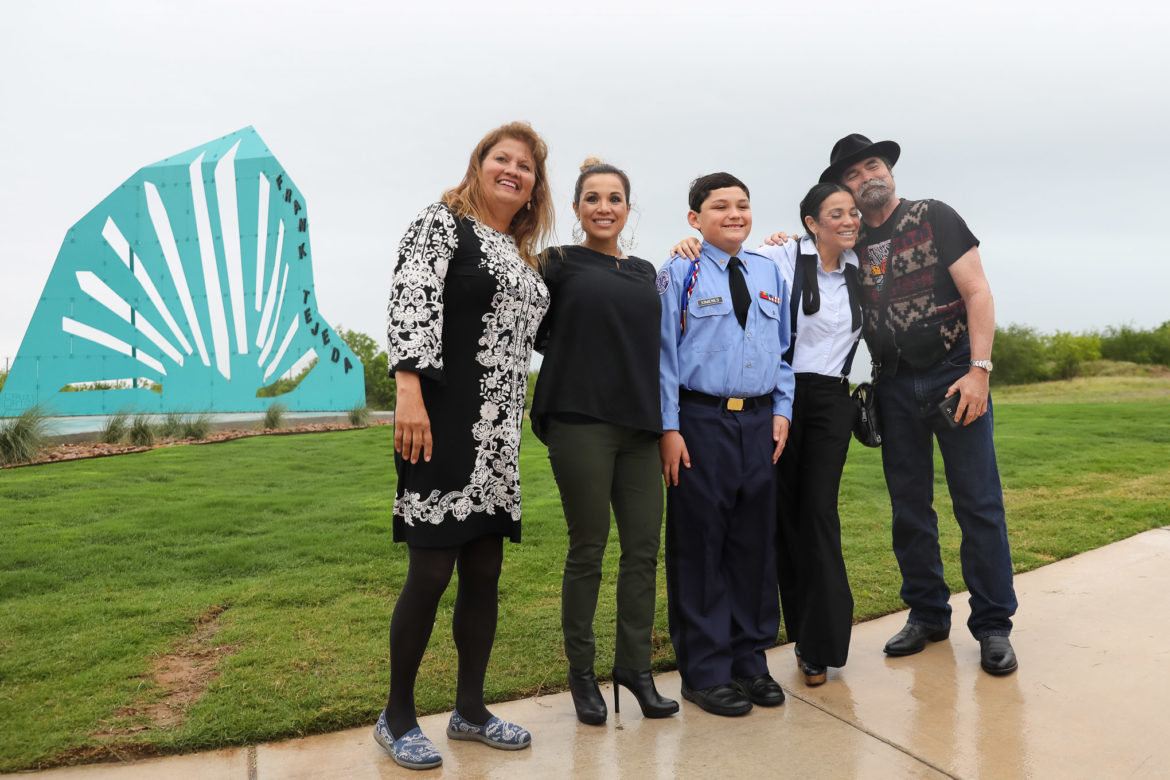 (from left) Elane Ortiz, Sonya Santoscoy, Robert Frank Ximenes, Marissa Tejeda, and Juan Tejeda pose in front of Sun Mountain honoring the late Frank Tejeda.
