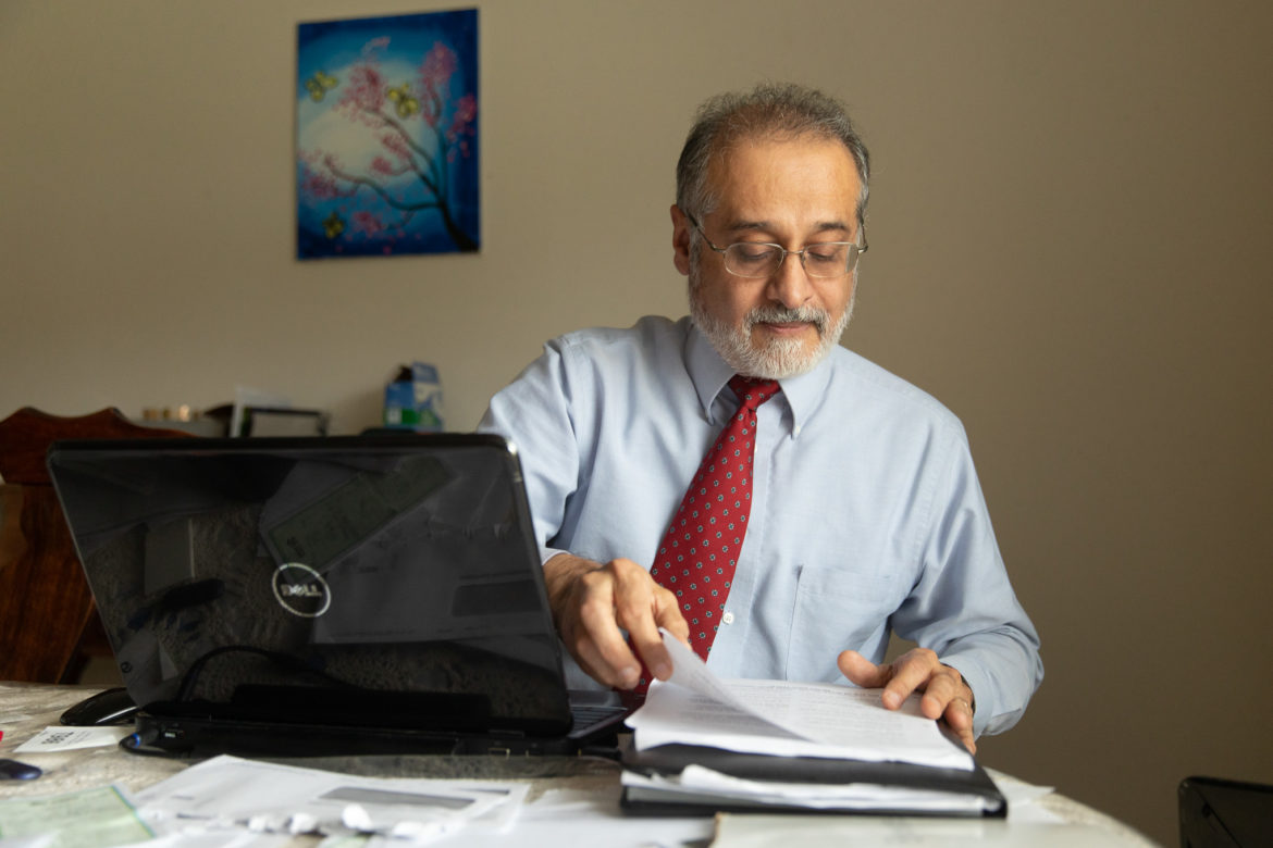 Cesar Bustos spends most of his time working on his writing in his home office.