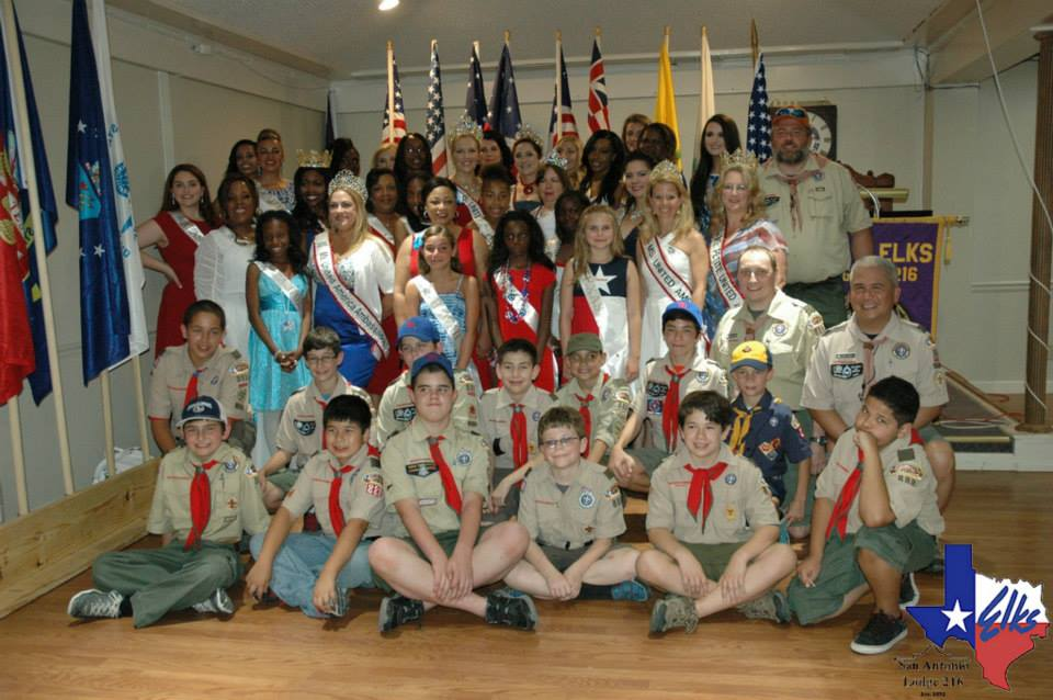 Boy Scouts from Helotes Troop 888 and pageant queens from United America Pageant participate at the San Antonio Elks Flag Day Festival Run 2014