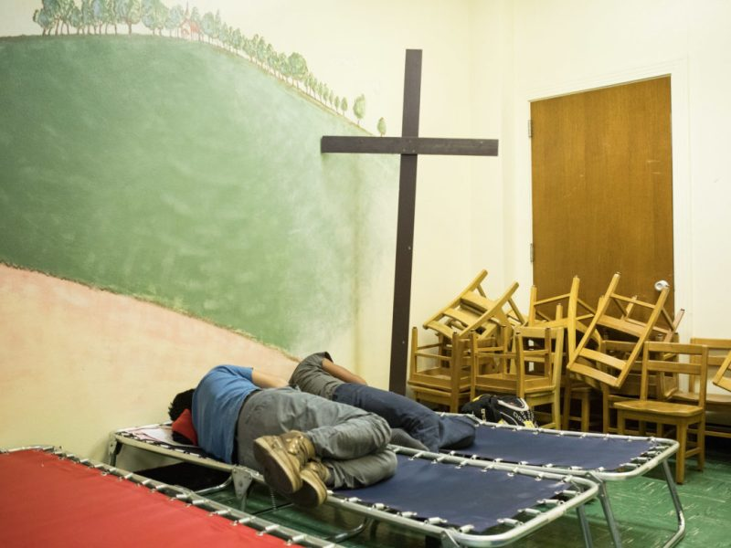 Boys sleep in cots after arriving at Travis Park United Methodist Church.