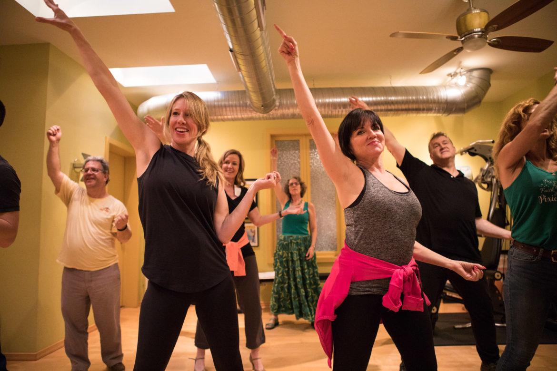 """Actors practice a dance number in """"An Adventurer's Journey."""""""