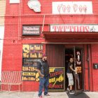 (From left) Raul Ortiz and Sanariaye Dixon share a laugh outside of Voodoo Tattoos.