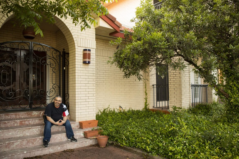 James Benavides sits on his front porch in Oak Hills.