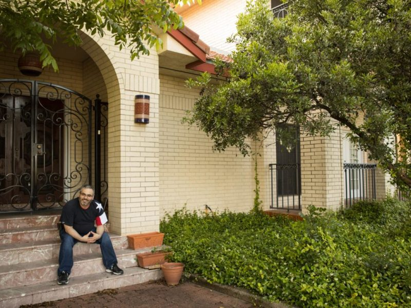 James Benavides sits on his front porch in Oak Hills.