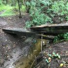 A bridge spanning a creek at Olmos Basin Park has seen better days.