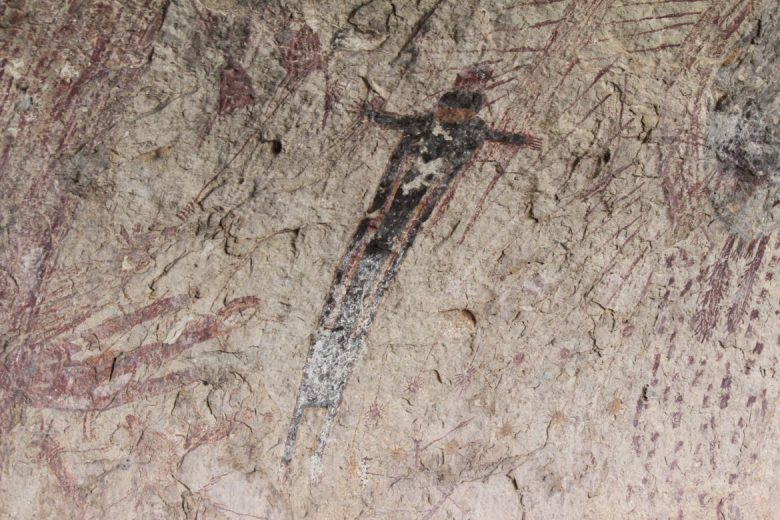 Prehistoric artists used a series of black, red, yellow, and white paints to create the figures at Panther Cave.