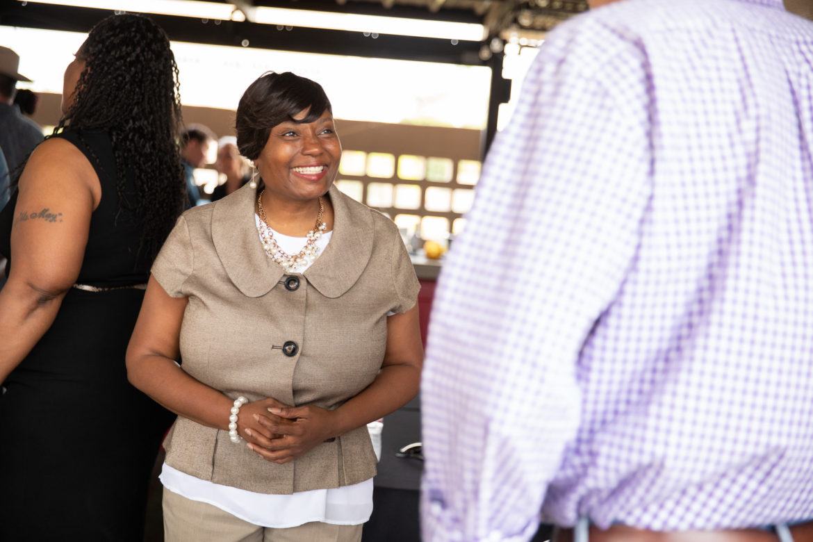 District 2 candidate Jada Sullivan talks with supporters in April.