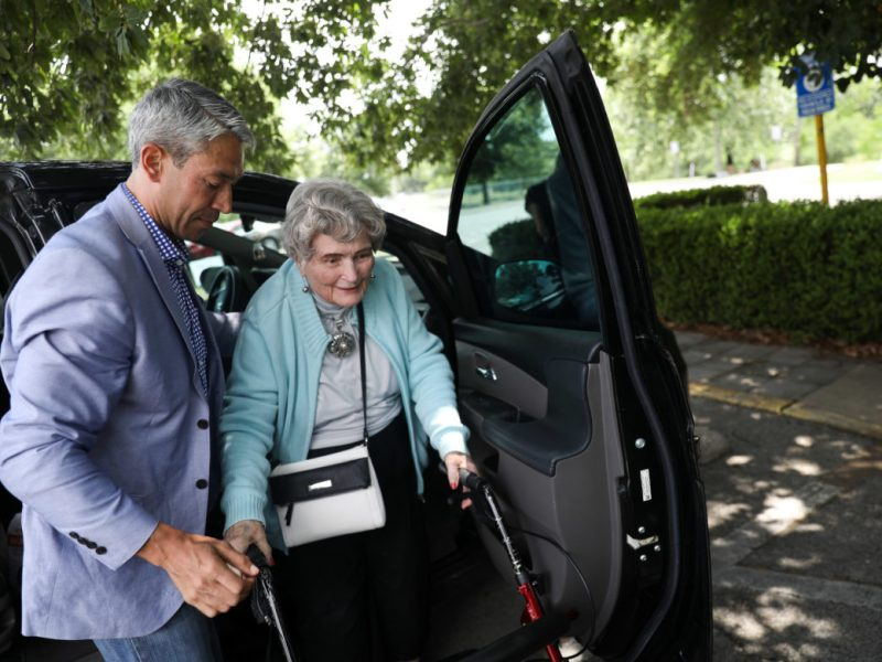 Mayor Ron Nirenberg helps former mayor Lila Cockrell out of a vehicle to so she can place her vote at Lion's Field Adult and Senior Center. Mayor Ron Nirenberg helps former mayor Lila Cockrell out of a vehicle to so she can place her vote at Lion's Field Adult and Senior Center.