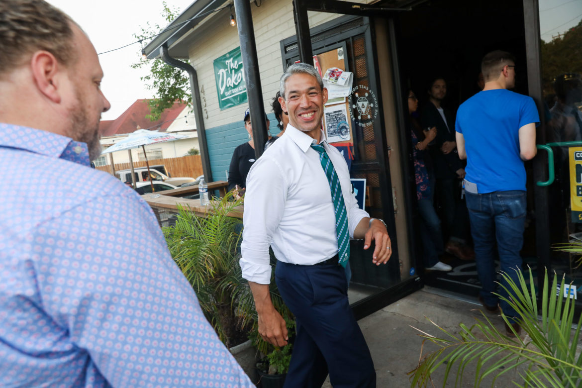 Mayor Ron Nirenberg greets Dakota East Side Ice House owner Kent Oliver as he arrives to a rally themed for younger voters.