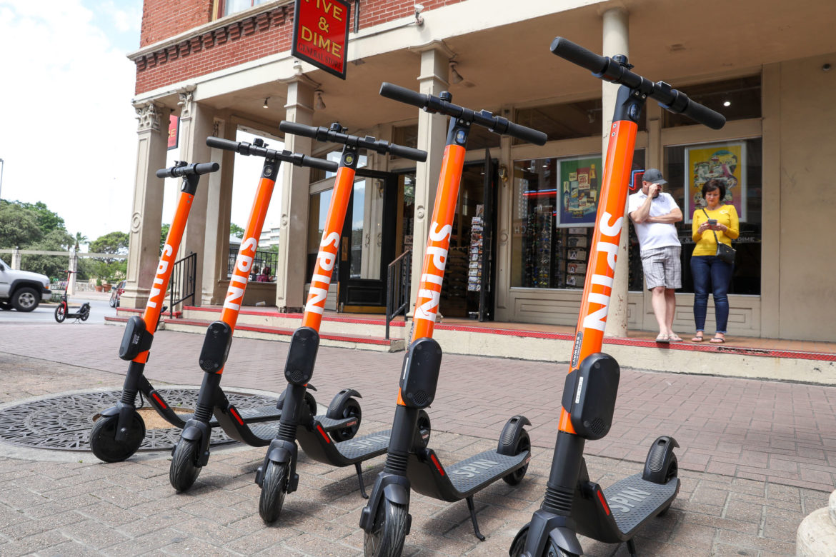 Spin scooters lined Alamo Street at the intersection of Commerce.