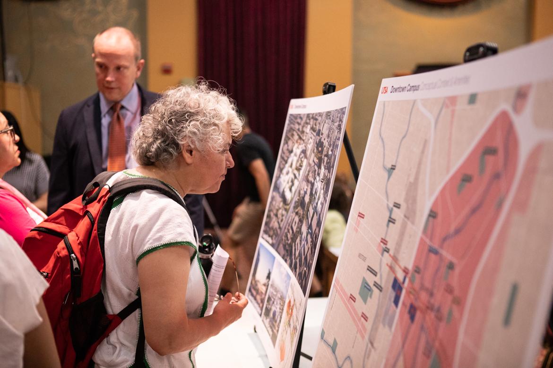 Graciela Sanchez, director of the Esperanza Center, looks at the renderings.