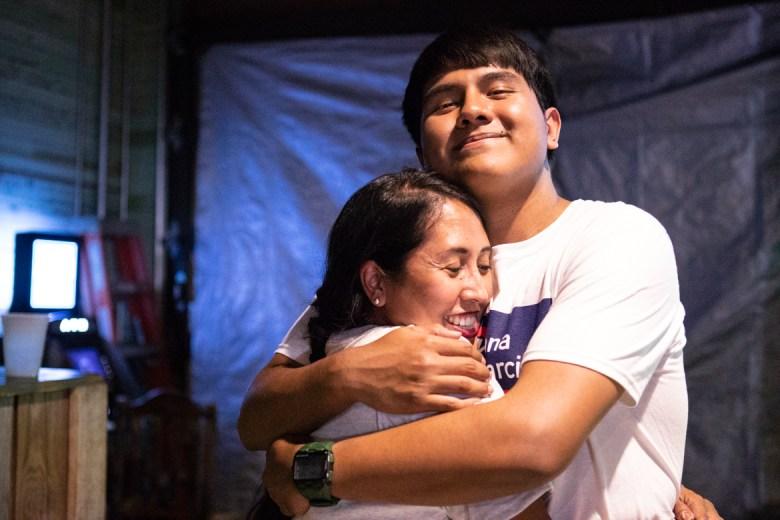 Adriana Rocha Garcia (left) hugs her son Steve Garcia III at her watch party.