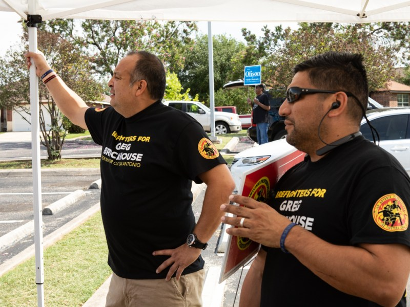 "(From left) Firefighters Roland Aguirre and Rene ""Bug"" Guerra answer questions on behalf of the Firefighter's Union in front of the Great Northwest Library."
