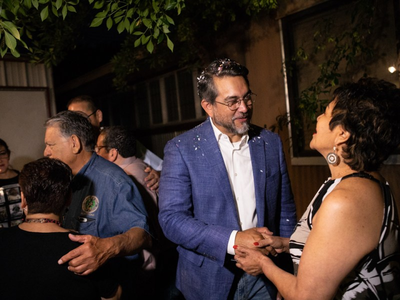 Councilman Roberto Treviño (D1) greets campaign supporters after hearing the results of early voting.