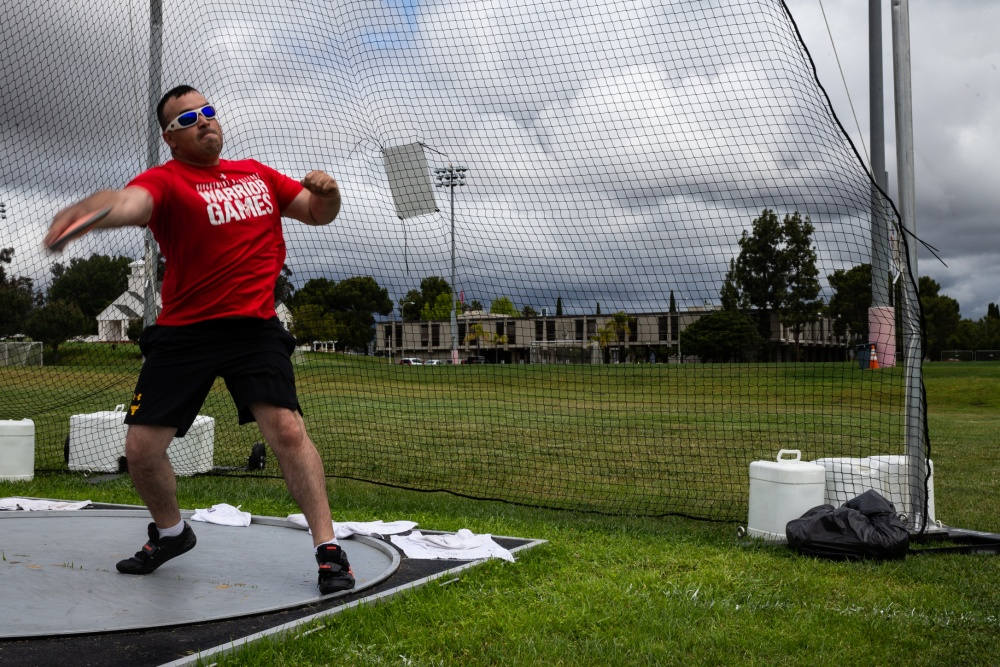 U.S. Marine Corps Cpl. Mathew Maddux throws a discus at Marine Corps Base Camp Pendleton, California, in preparation for the 2019 Warrior Games. Maddux is a recovering service member at Wounded Warrior Detachment-San Antonio.