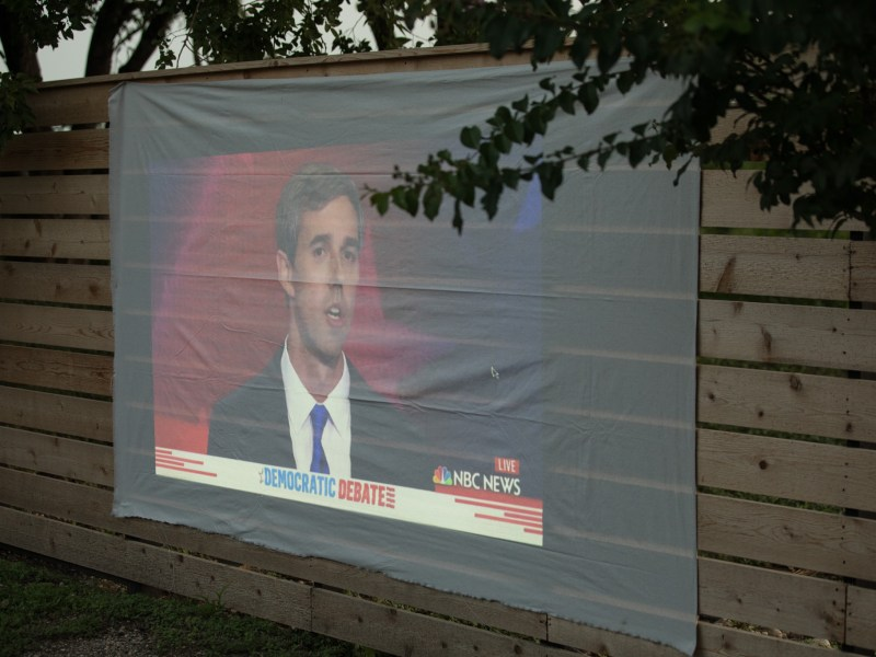 Presidential candidate Beto O'Rourke is displayed on a projector at the Burnt Nopal Democratic debate watch party.