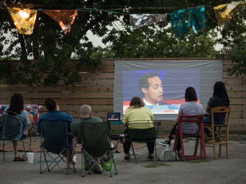 Presidential candidate Julián Castro is displayed on a projector at the Burnt Nopal Democratic debate watch party.