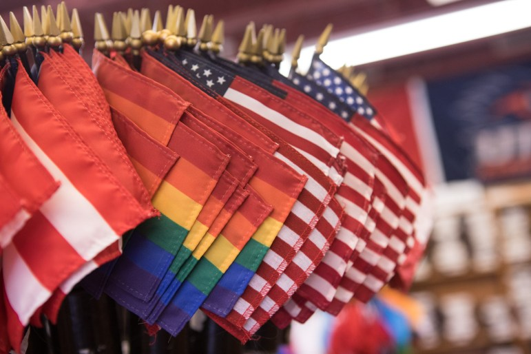 Small flags are available for sale in the store front of Dixie Flag & Banner Company.