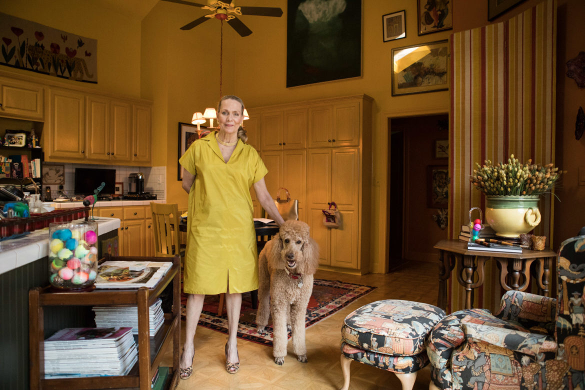 Kye Fox stands in the kitchen with her dog Elvis.