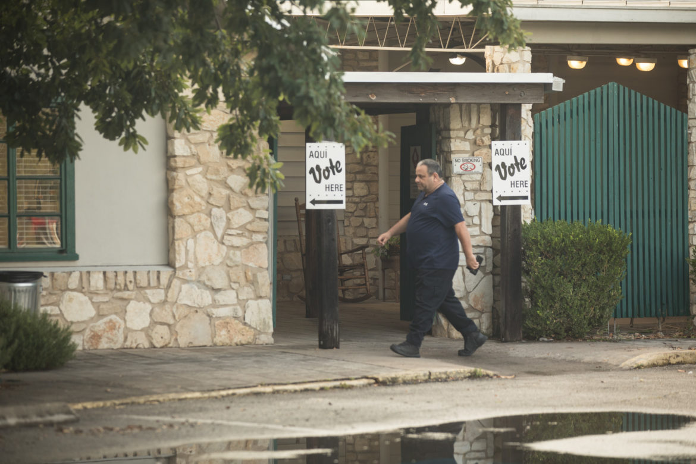 A man walks toward the Lion's Field poll site.