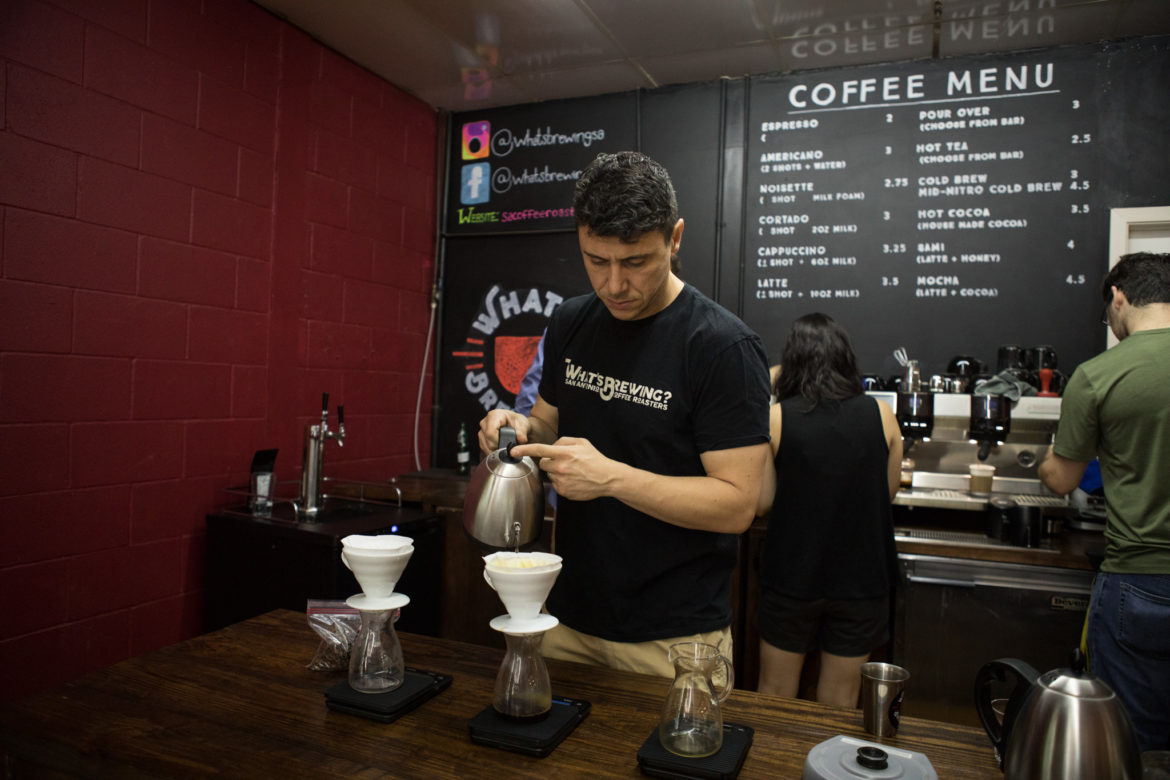 What's Brewing Coffee Roasters co-owner Sami Chbeir serves coffee to customers.