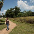 Taylor Watson walks through Mahncke Park.