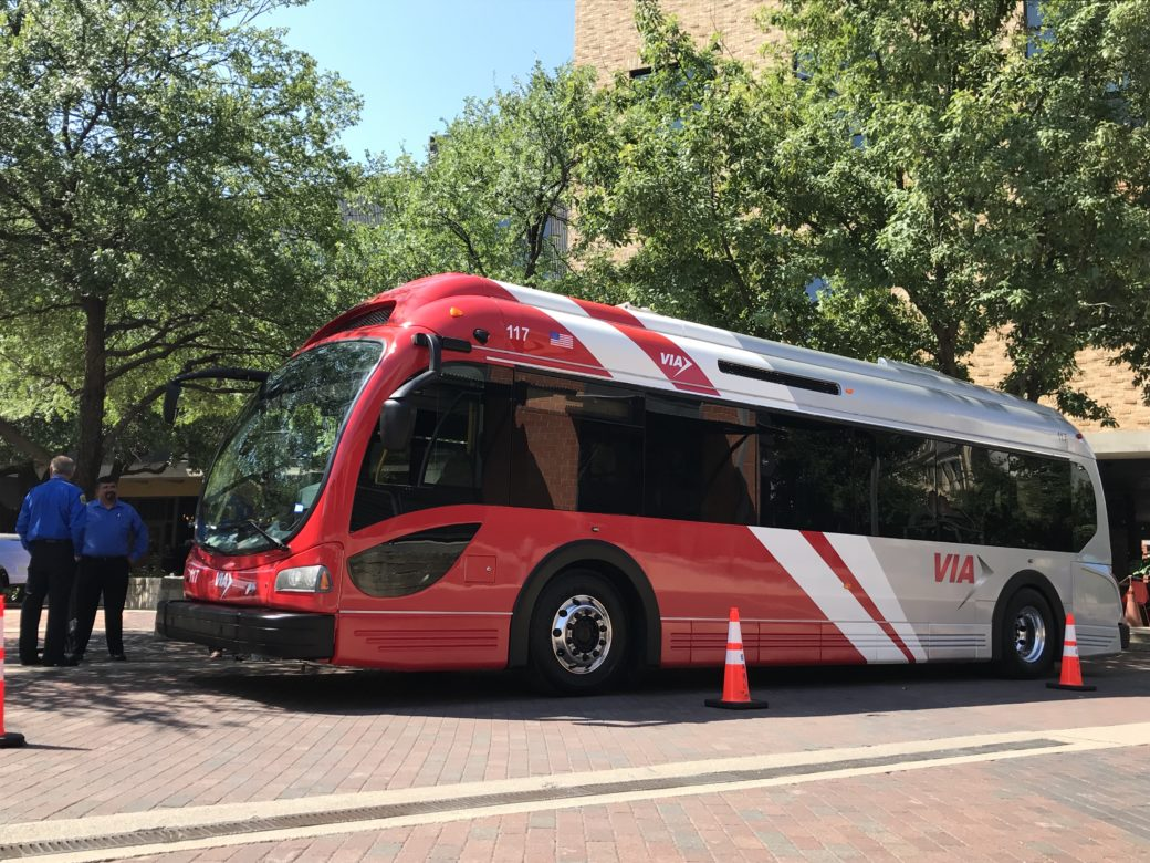 A VIA Metropolitan Transit electric bus sits outside the Pearl Stable during a summit on electrification and technology.