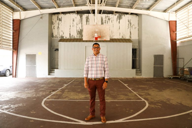 Luis Vargas stands in the same basketball court he grew up playing at the House of Neighborly Service.
